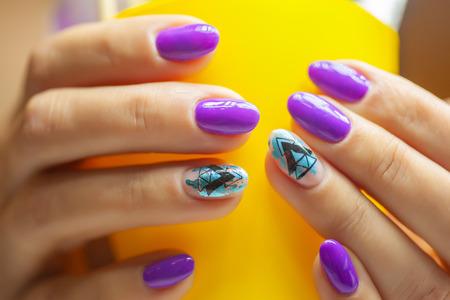 Female hands in manicure salon with a beautiful manicure Reklamní fotografie - 121845948
