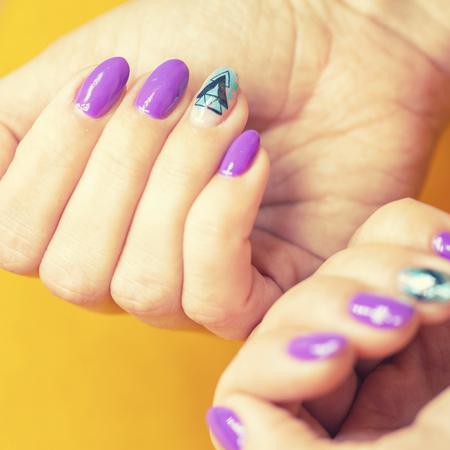 Female hands in manicure salon with a beautiful manicure Reklamní fotografie - 121845949
