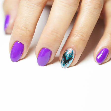 Female hands in manicure salon with a beautiful manicure Reklamní fotografie - 121845950