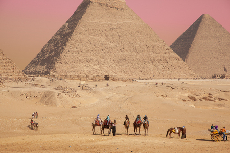 Cairo, Giza plato Egypt - Feb 08 2019: General view of pyramids with a tourists Redactioneel
