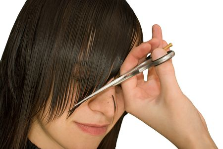 hairdresser is cutting young woman Stock Photo - 4869272