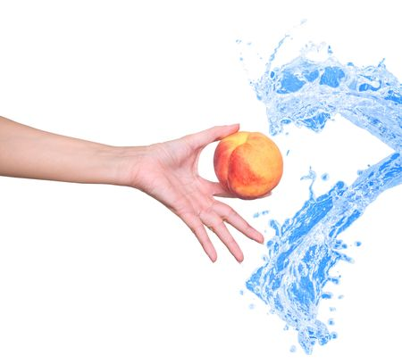 peach in the womans hand  Фото со стока