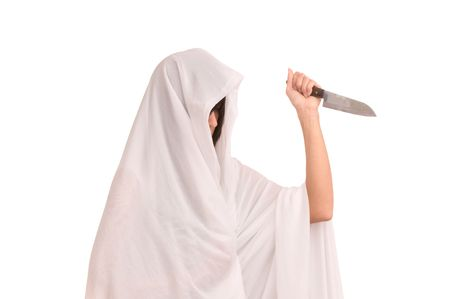 woman in white soutane with knife Stock Photo - 5494068