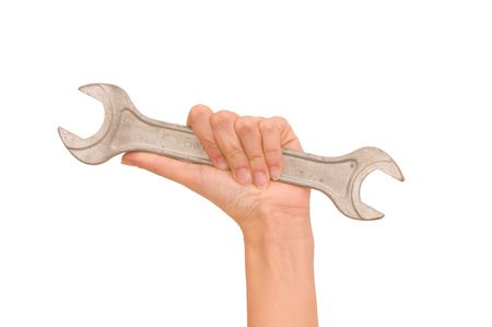 womans: spanner in the womans hand  Stock Photo