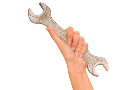 spanner in the womans hand  photo