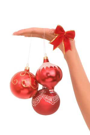 christmastree:  three Christmas-tree balls in the hand  Stock Photo