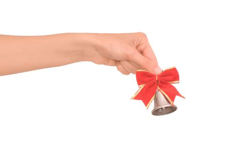 hand bell with red bow in the womans hand  photo