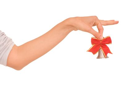 woman hanging toy: hand bell with red bow in the womans hand