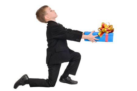 boy presenting a gift for his little love photo