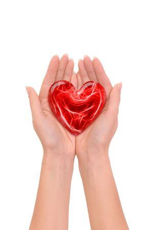 cuore nel le mani: Woman holding cuore rosso in mano