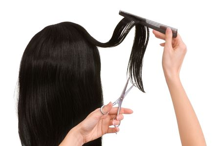 haircutting: hairdresser cutting young woman with long black hair  Stock Photo