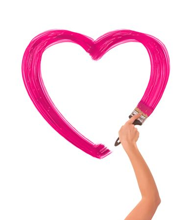 shape heart: painter drawing pink heart on the wall as a symbol of love