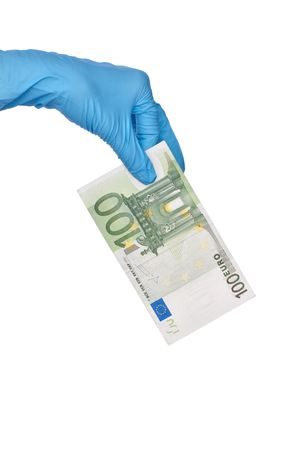 doctor putting money: doctor holding fake of hundred euro in the hand