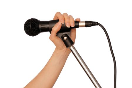 woman holding a black microphone for singing, speaking and speech Stock Photo - 6907655
