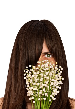 woman smelling bouquet of lilies of the valley Stock Photo - 7093058