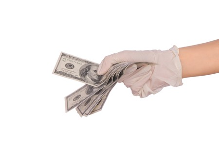 doctor with dollars: doctor take of dollars in the hand