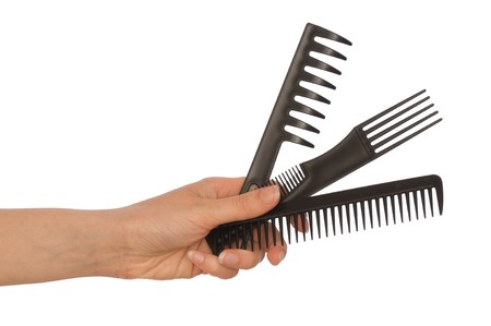 hairdresser holds the black tools for haircut Stock Photo - 7230104