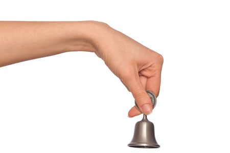 hand bell in the womans hand for ringing