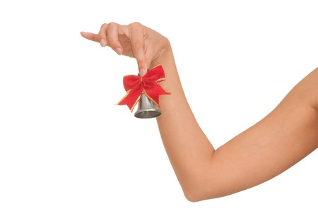 hand bell in the womans hand for ringing photo