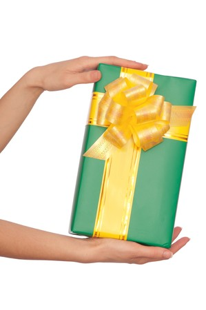 woman giving a green box with yellow bow as a gift photo