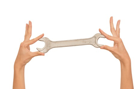 woman holding chrome vanadium spanner in the hands photo