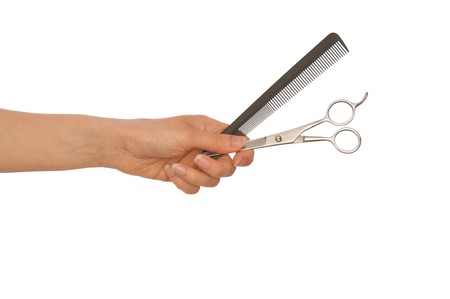 hairdresser holds scissors and hairbrush for haircut Stock Photo - 7266944