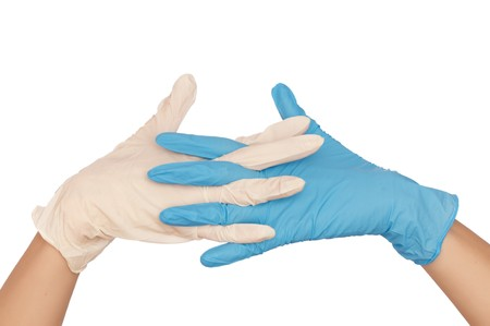 sterilized: doctor put blue and white sterilized medical glove for making operation