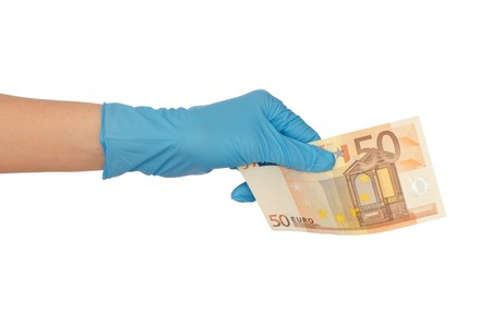 counterfeiting: doctor holding fake of 50 euro in the hand