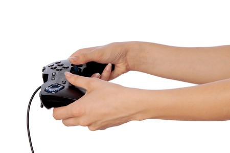 gamepads: The girl plays a computer game with the help joypad Stock Photo