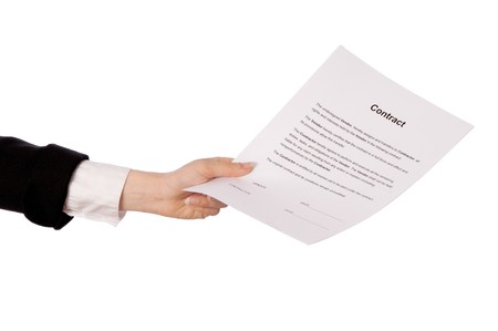 signing authority: The new worker holds the contract in the hand