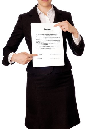 specifies: The managing director specifies in places for signatures in the contract Stock Photo