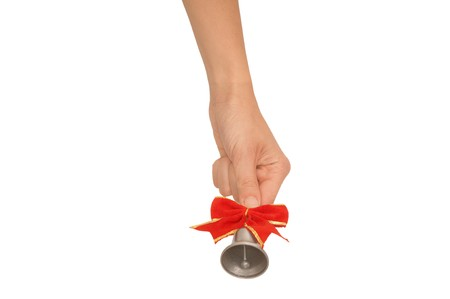 hand bell with red bow in the womans hand for ringing photo