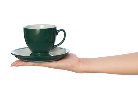 woman takes to hand the one cup of tea photo