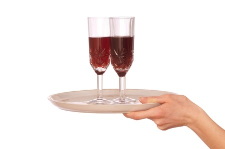 Waiter hold the tray with three glasses champagne photo