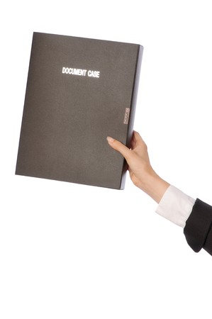 The new worker puts a document case on the top shelf photo