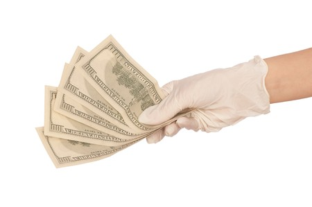 doctor with dollars: doctor take of fake dollars in the hand