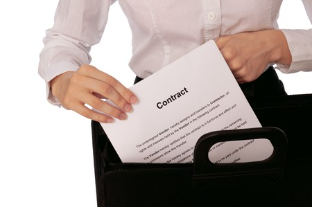The managing director holds the contract in the hands