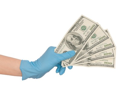 bogus: doctor take of fake dollars in the hand