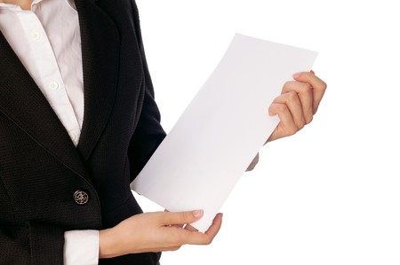 signing authority: The managing director holds the white blank paper in the hand