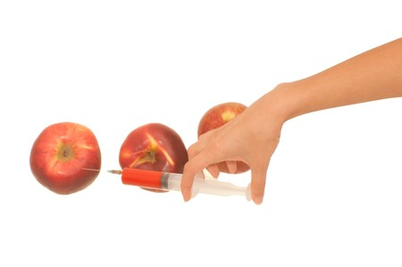chemical peels: Poison in a syringe is injected into apples