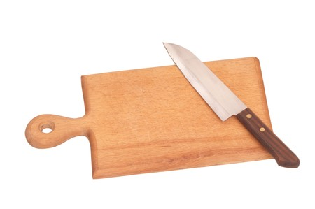 board with knife on the kitchen for meat cutting photo