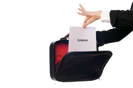 attest: Investigator examines in details the materials of evidence reported by advocate Stock Photo