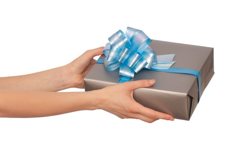 woman giving a silver box with blue bow as a gift photo