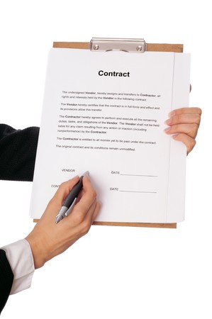 continuation: Vendor signing the contract as a continuation of relationship Stock Photo
