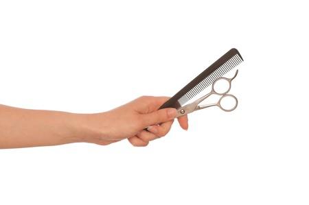 hairdresser holds scissors and hairbrush for haircut