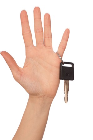 Key from the new house in hands of the woman photo