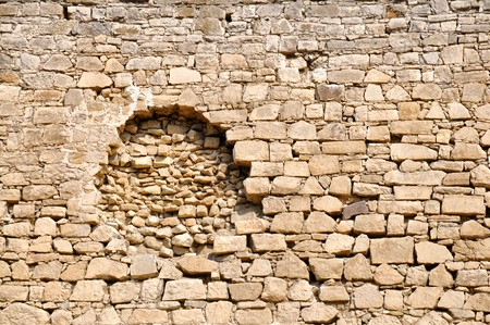 Damaged brick wall of the fortress as a background Stock Photo - 7830466