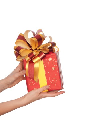 woman giving a red box with yellow bow as a gift Stock Photo