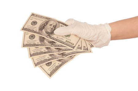 doctor putting money: The criminal took dirty money in hands