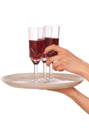 A waiter takes a glass of champagne from a tray with three glasses photo